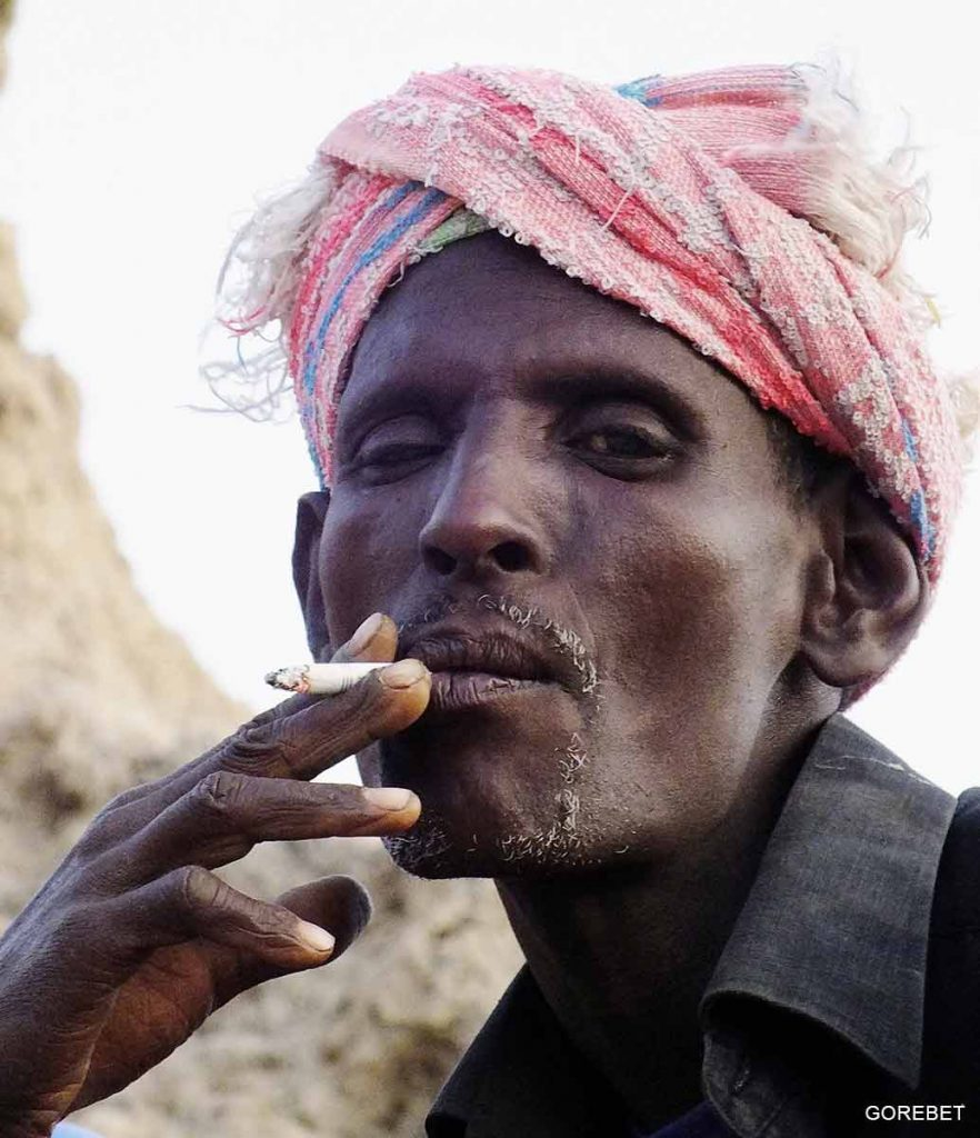 afar man smoking ciggarate